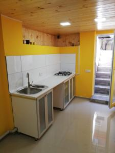 A kitchen or kitchenette at Inauri House