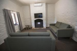 A seating area at Paxton Square Cottages