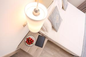 A bed or beds in a room at Alma di Alghero Apartments