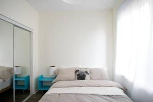 A bed or beds in a room at The Durocher Apartments