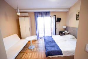 A bed or beds in a room at Villa Matea Apartment
