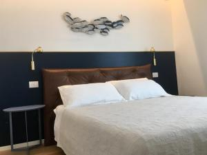A bed or beds in a room at Ponte dei Voltoni Apartment