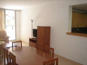A television and/or entertainment center at Apartments Nausica Beach
