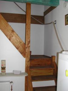 A bed or beds in a room at Gite Les Bruyeres 123 Sologne