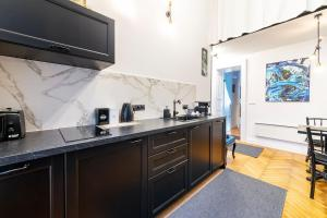 A kitchen or kitchenette at MARCHESE aptm. BUDApest - luxury living next to Chain Bridge