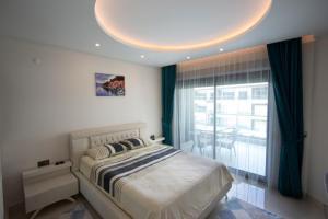 Un pat sau paturi într-o cameră la Konak Seaside Resort