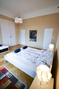 A bed or beds in a room at Best Apartment