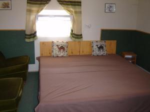Кровать или кровати в номере Apartmanház Mediterrán