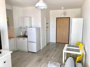 A kitchen or kitchenette at Apartament La Venda Marie
