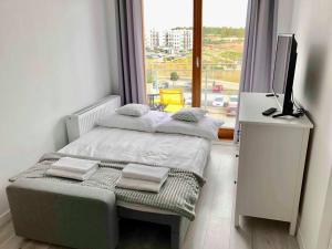A bed or beds in a room at Apartament La Venda Marie
