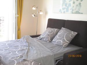 Un ou plusieurs lits dans un hébergement de l'établissement Au bon air