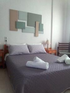 A bed or beds in a room at Ostria Rooms