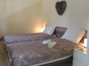 Un ou plusieurs lits dans un hébergement de l'établissement Le Bananier