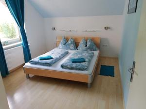 Postelja oz. postelje v sobi nastanitve Apartments Mertelj
