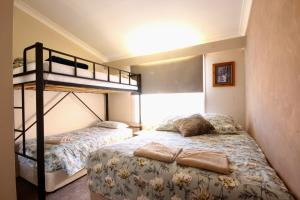 A bunk bed or bunk beds in a room at Full Circle Apartments