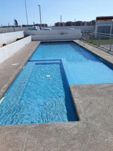 The swimming pool at or near Departamento Gabriela
