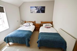 A bed or beds in a room at River Exe Apartment