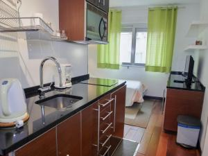 A kitchen or kitchenette at DFlat Escultor Madrid Apartments