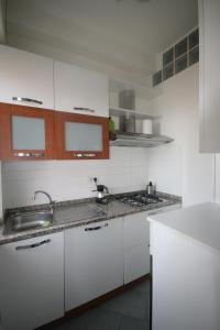 A kitchen or kitchenette at Navigli Apartment