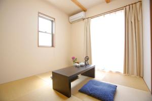 A bed or beds in a room at Apartment in Kyoto 3060
