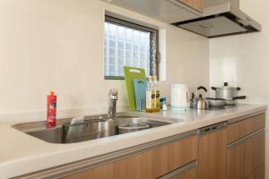 A kitchen or kitchenette at Apartment in Kyoto 3060