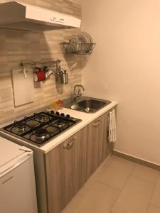 O bucătărie sau chicinetă la Casetta del Balzo