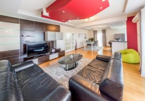Zona de estar de Apartments LUPE