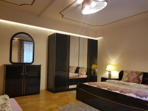 A bed or beds in a room at Palma Villa in City Park Budapest