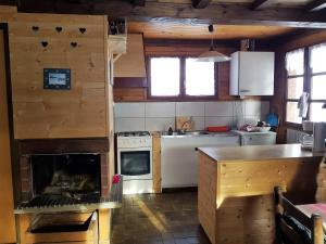 Cuisine ou kitchenette dans l'établissement les Gentianes 29D