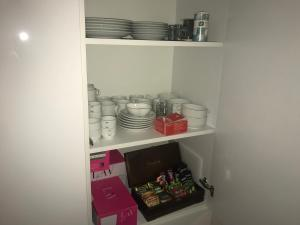 A kitchen or kitchenette at North Avenue Modern Apartments