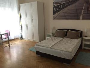 A bed or beds in a room at Jazz Apartment