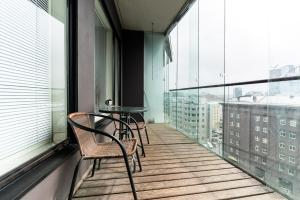 Балкон или терраса в Hilltop Apartments - City Centre Foorum
