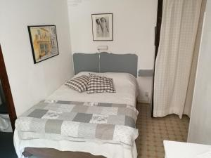 Vuode tai vuoteita majoituspaikassa Villa Asmodée