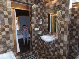 Kupaonica u objektu Green Bowl Beach Villas