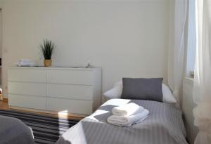 A bed or beds in a room at Belvedere Apartment