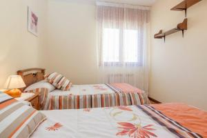 A bed or beds in a room at Casa Pauli