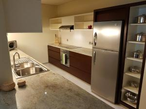 A kitchen or kitchenette at Ascott Park Place Dubai