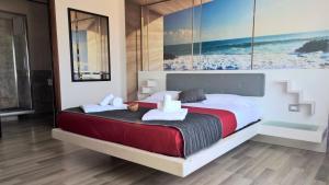 Letto o letti in una camera di Residence Villa Rosa dei Venti