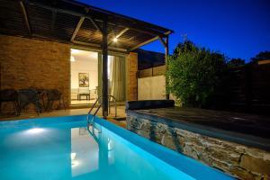 The swimming pool at or near Gerakari Suites