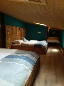 A bed or beds in a room at Apartments Helsen