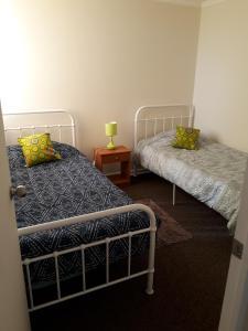 Uma cama ou camas num quarto em Departamento Gabriela