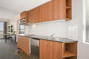 A kitchen or kitchenette at Mantra Parramatta