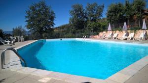 The swimming pool at or near Residence Casa Lama