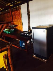 A television and/or entertainment center at Native-Style Villa by Eugene's Place