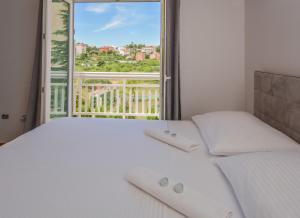 Cama o camas de una habitación en Apartments LUPE