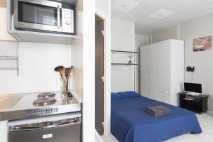 Cuisine ou kitchenette dans l'établissement Résidence Carpe Diem