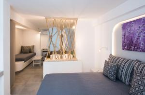 A bed or beds in a room at Mina Studios