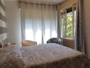A bed or beds in a room at Villa Olivia