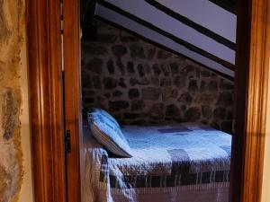 A bed or beds in a room at El torreón del Adarve