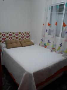 A bed or beds in a room at Casa De Ana
